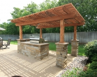 811-cedar-pergola-with-stone-columns-midway-up-the-posts-rocked-in-bbq-flagstone-countertop