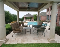 817-travertine-decking-round-columns-tongue-and-groove-ceiling-with-fans