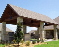 818-outdoor-kitchen-granite-countertops-sink-stone-columns-tongue-and-groove-ceiling-with-fans-bbq-refrigerator-amenities_0