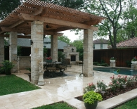 821-outdoor-kitchen-granite-countertops-travertine-deck-stone-columns-tongue-and-groove-ceiling-with-fans-bbq-refrigerator-amenities