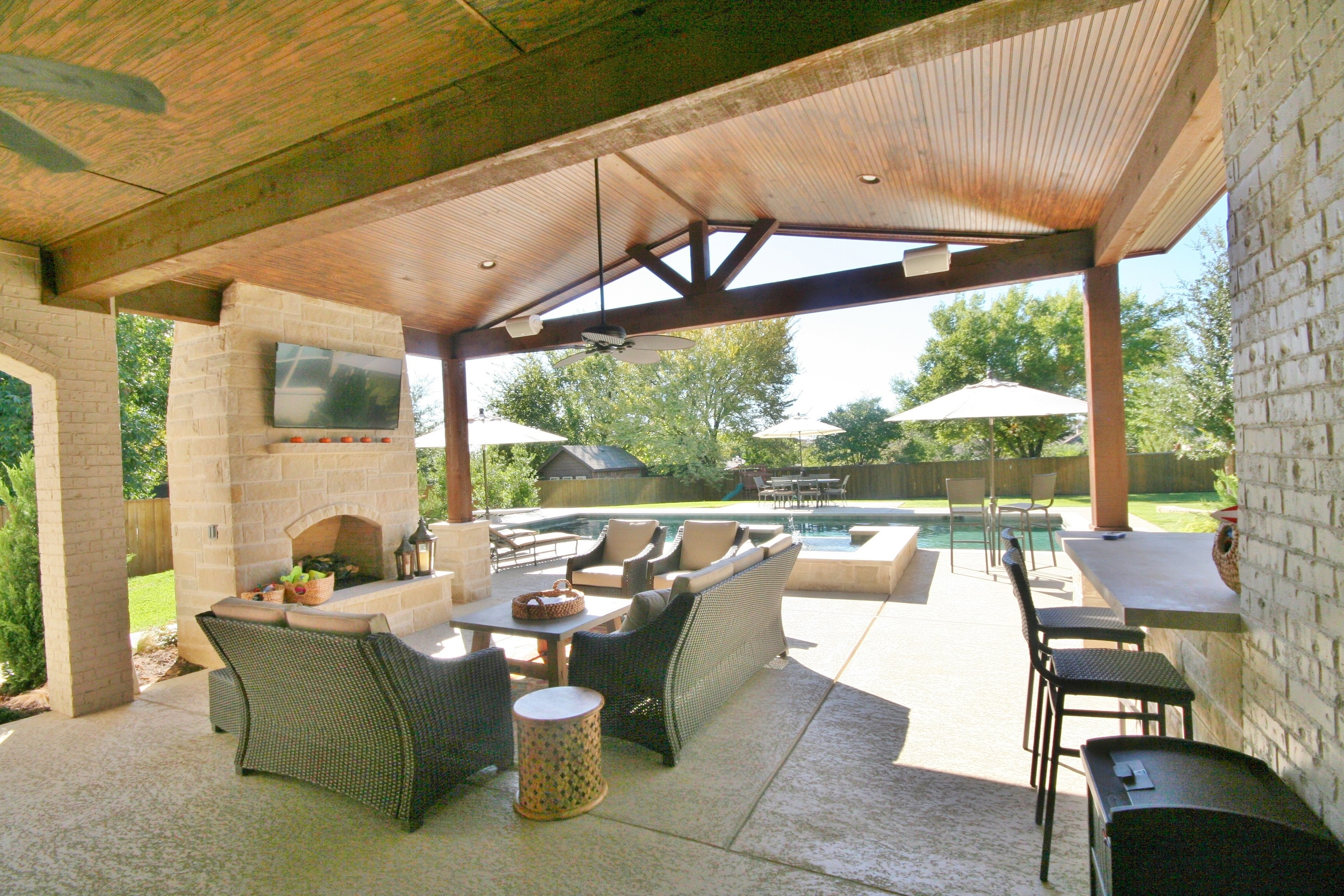 Raised bar with Leuders, Solid roof structure with Lighting, fireplace, Sundek & Zodiac Equipment