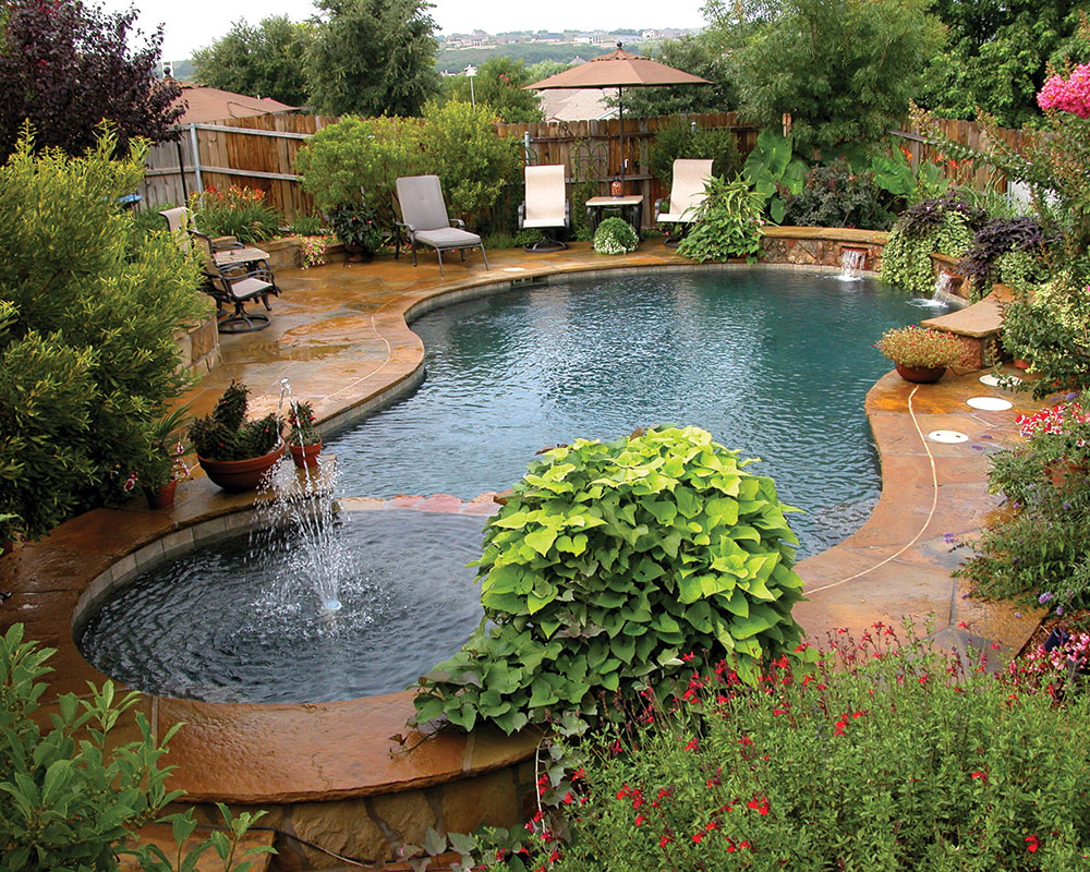 Free Form Pool With Flagstone Decking, Water Feature With Sheer Descents,  Rock Planters,
