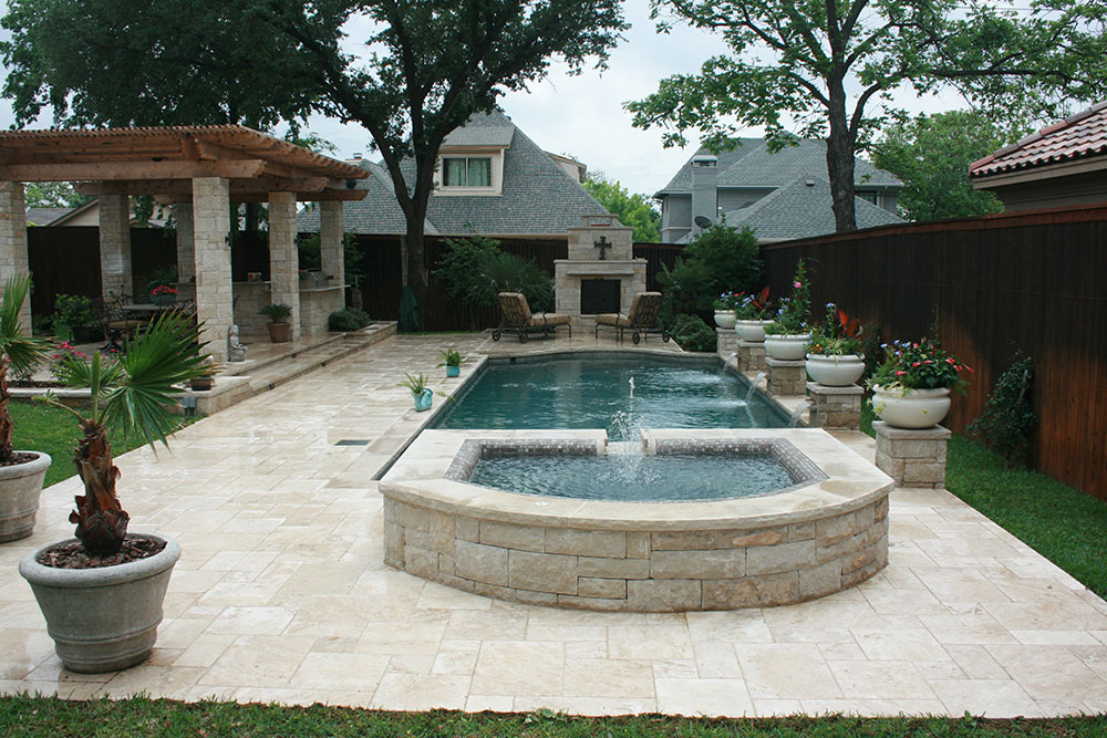 Traditional Pool Attached Spa With Pergola Rounded Tile Ledge Outdoor Kitchen Fireplace