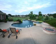 Freeform Pool, Spa, and Outdoor Kitchen; Endless Pool, Fast Lane, Seating Bench, Fire Pit, Interfab Diving Board, Wet Edge Plaster, Zodiac Equipment
