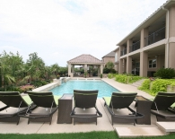 Straight-line Pool: Bubbler Fountains in Steps, Outdoor Kitchen, Water Feature, Fire Pit, Sitting Area, Zodiac & Polaris Equipment