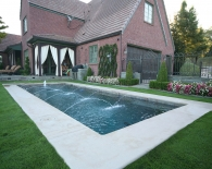 Traditional Pool; Bubbler Fountain in Step, Deck Jets, Wet Edge Plaster, Zodiac Equipment