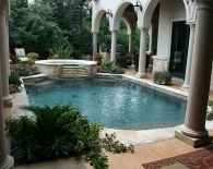 Traditional Pool with Radius Spa, Step Down Overflow, Granbury Coping, Salt Deck, Pebble Plaster, Zodiac Equipment