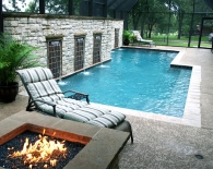 Traditional Pool with Custom Privacy Wall and Water Features, Fire Pit, Screened Enclosure, Sundek, White Plaster, Zodiac Equipment
