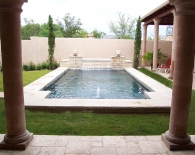 Traditional Pool, Attached Spa with Rounded Tile Ledge and Step Down Overflow, Lion Fountains, Bubbler in Tanning Ledge, Wet Edge Plaster, Zodiac Equipment