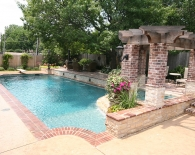 Traditional Pool; Attached Spa with Pergola, Rounded Tile Ledge and Angled Overflow; Sheer Over Flow Fountain and Lions Head Fountains, Double Brick Coping