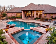 Traditional Pool and Spa, LED Deck Jets, Wok Bowl Fountains, Multilevel Steps, Interfab Hand Rail, Aggregate Decking