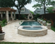 Traditional Pool; Attached Spa with Pergola, Rounded Tile Ledge; Outdoor Kitchen, Fireplace, Oreq Water Features, Travertine Decking, Planter Bowls