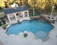 Freeform Pool; Tanning Ledge, Rock Waterfall, Multicolor Brown Coping, Aggregate Decking, Wet Edge Plaster, Zodiac Equipment