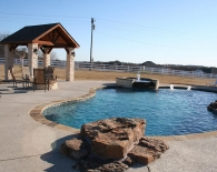 Freeform Pool and Spa; Fountain, Flagstone Coping, Jump Rock, Bubbler, Fountains in Bench, Fire Pit, Pergola, Wed Edge Plaster, Zodiac & Polaris Equipment