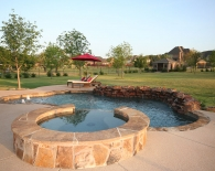 Freeform Pool; Flagstone Coping, Sundeck, Bubbler Fountains in Step, Weeping Wall, Wet Edge Plaster, Zodiac & Polaris Equipment