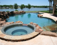 Freeform Pool and Spa; Rock Bench Entry, Sundek, Weeping Wall, Rock Waterfall and Grotto, Wet Edge Plaster, Zodiac & Polaris Equipment