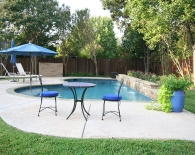 Freeform Pool; Straight-line Back, Raised Water Feature, Umbrella Sleeve in Step, Wet Edge Plaster, Zodiac & Polaris Equipment