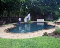 Freeform Pool; Flagstone Coping, Pavers Deck, Slide, Wet Edge Plaster, Zodiac & Polaris Equipment