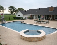Traditional Pool and Spa; Deck Jets, Sundek Decking, Accent Boulders, Turbo Slide, Outdoor BBQ Area, Bubbler Fountains, Wet Edge Plaster, Zodiac & Polaris Equipment