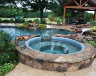 Freeform Pool; Rock Beach Entry with Bubbler Fountains, Spa Deck Jets, Slide, Grotto, Waterfall, Sundek, Wet Edge Plaster, Zodiac & Polaris Equipment