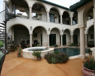 Traditional Pool and Spa; Step-Down Overflow, Granbury Coping, Salt Deck, Pebble Plaster, Zodiac & Polaris Equipment