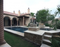 Traditional Pool and Spa; Rounded Tile Ledge and Step-Down Overflow, Lion Fountains, Bubbler in Tanning Ledge, Wet Edge Plaster, Zodiac Equipment