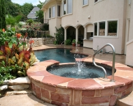 Freeform Pool and Spa; Rock Weeping Wall, Multi-color Flagstone Coping, Patterned Concrete Decking, Pebble Plaster, Zodiac & Polaris Equipment