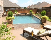 Traditional Pool; Rock Beach Entry, Spa Sundeck Fountains, Wet Edge Plaster, Zodiac & Polaris Equipment