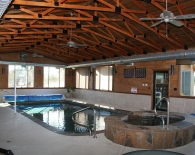 Traditional Indoor Pool and Spa; Flagstone Coping, Sundek Decking, Pool Cover, Wet Edge Plaster, Zodiac & Polaris Equipment