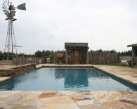Traditional Pool: Wood Covered Spa, Flagstone Coping and Decking, Raised Cascading Water, Feature Fire Pit, Wet Edge Plaster, Zodiac & Polaris Equipment