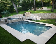 Traditional Pool and Spa with Stepdown Overflow, Lion Head Fountains, Wet Edge Plaster, Zodiac & Polaris Equipment