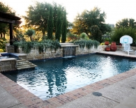 Traditional Pool and Spa with Pergola, Rounded Tile Ledge and Angled Overflow Sheer, Overflow Fountains and Lions Head Fountains, Double Brick Coping