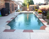 Traditional Pool; Multicolored Flagstone, Water Columns with Fountains, Sundek Decking, Dunn Rite Basketball Game, Wet Edge Plaster, Zodiac & Polaris Equipment