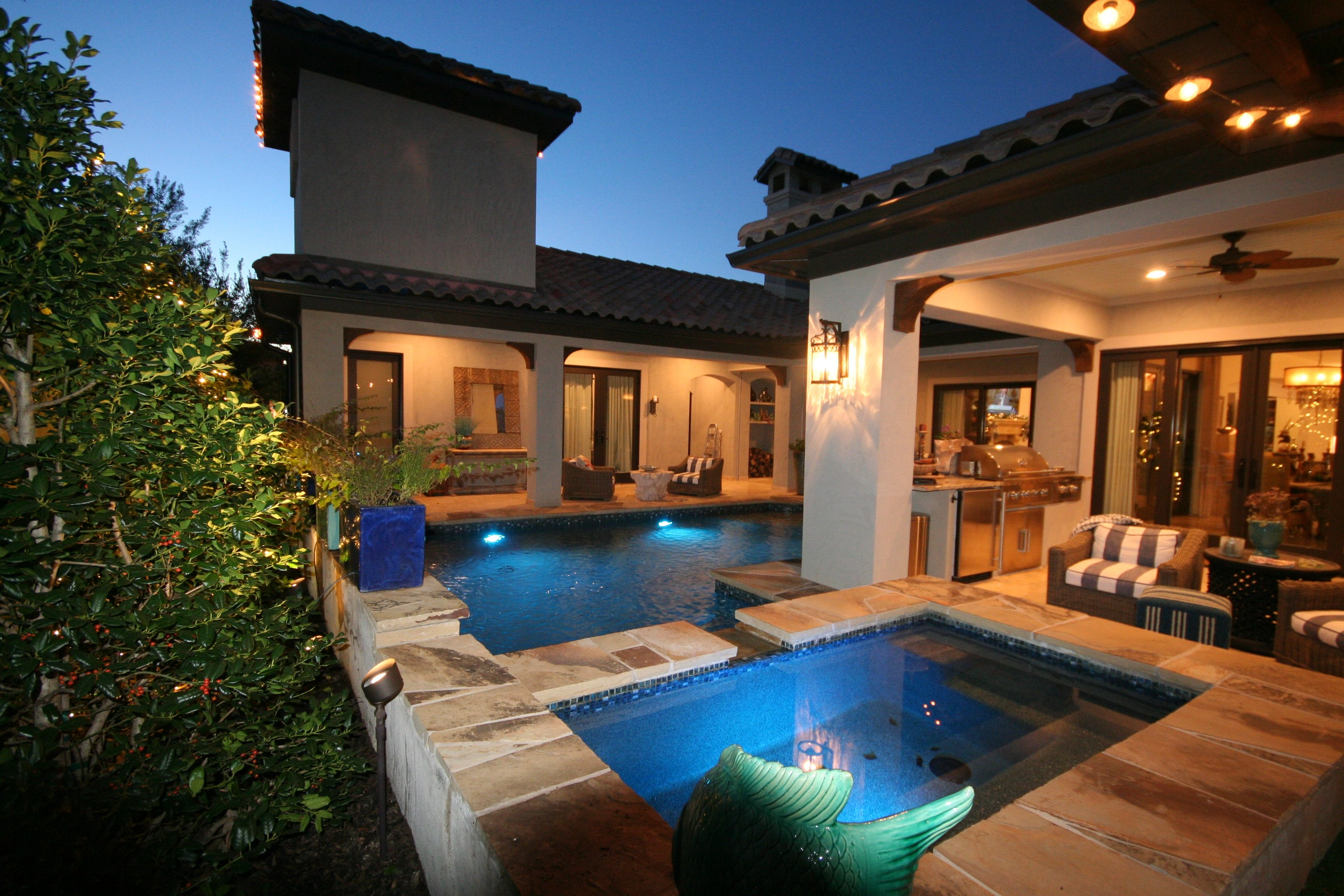 Geometric pool- Oklahoma flagstone, Wet Edge Northshore Tahoe, Bubbler, Raised Beam with Port Fountains & Zodiac Equipment.