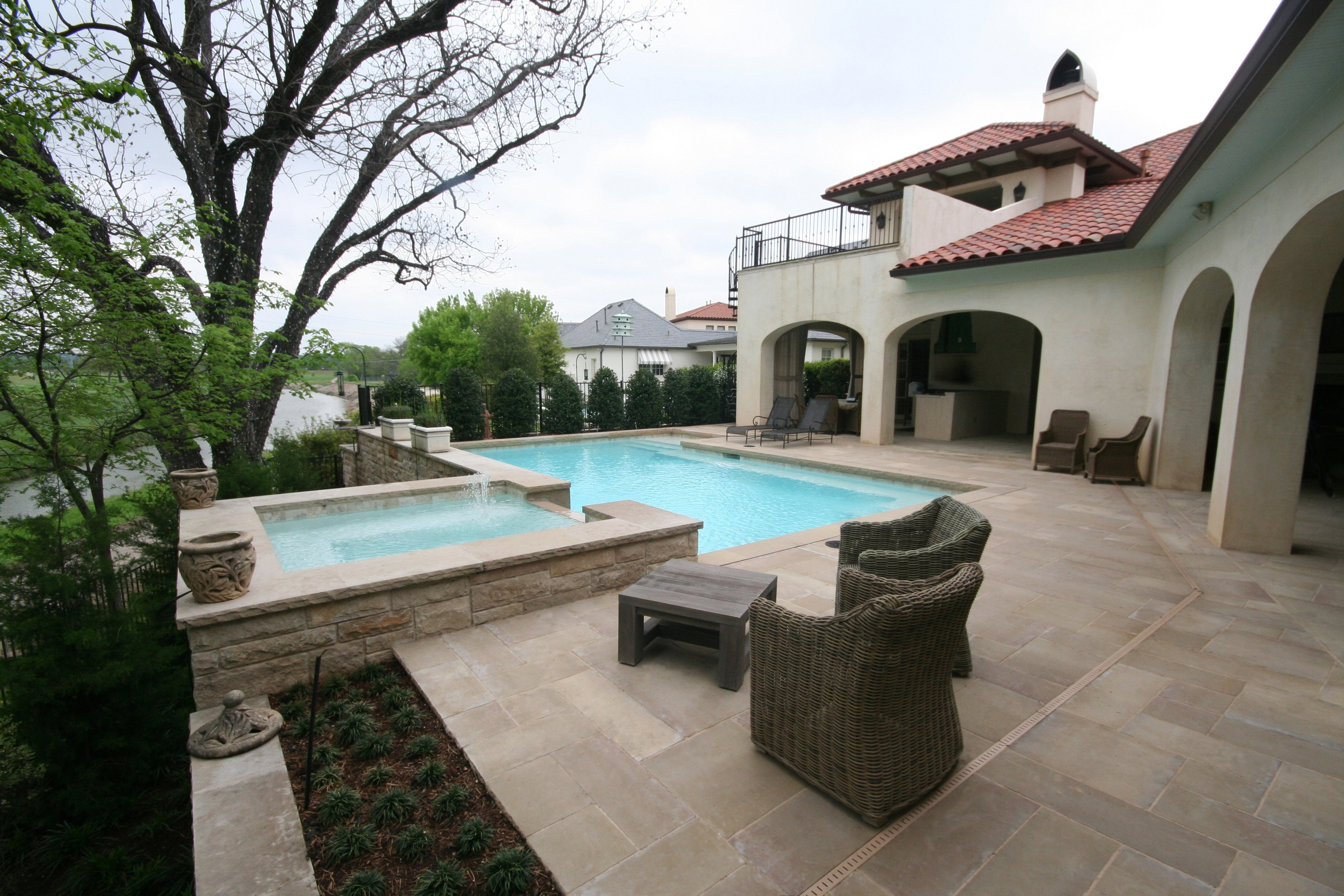 Geometric pool, White plaster, Pavers, Leuders coping, raised wall & Zodiac Equipment