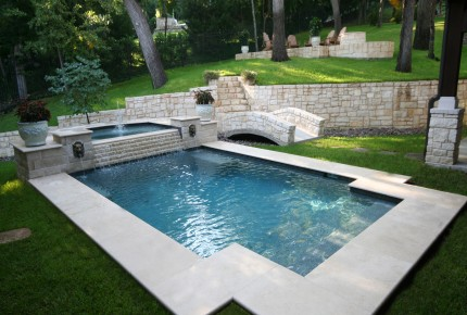 Geometric pool with raised spa